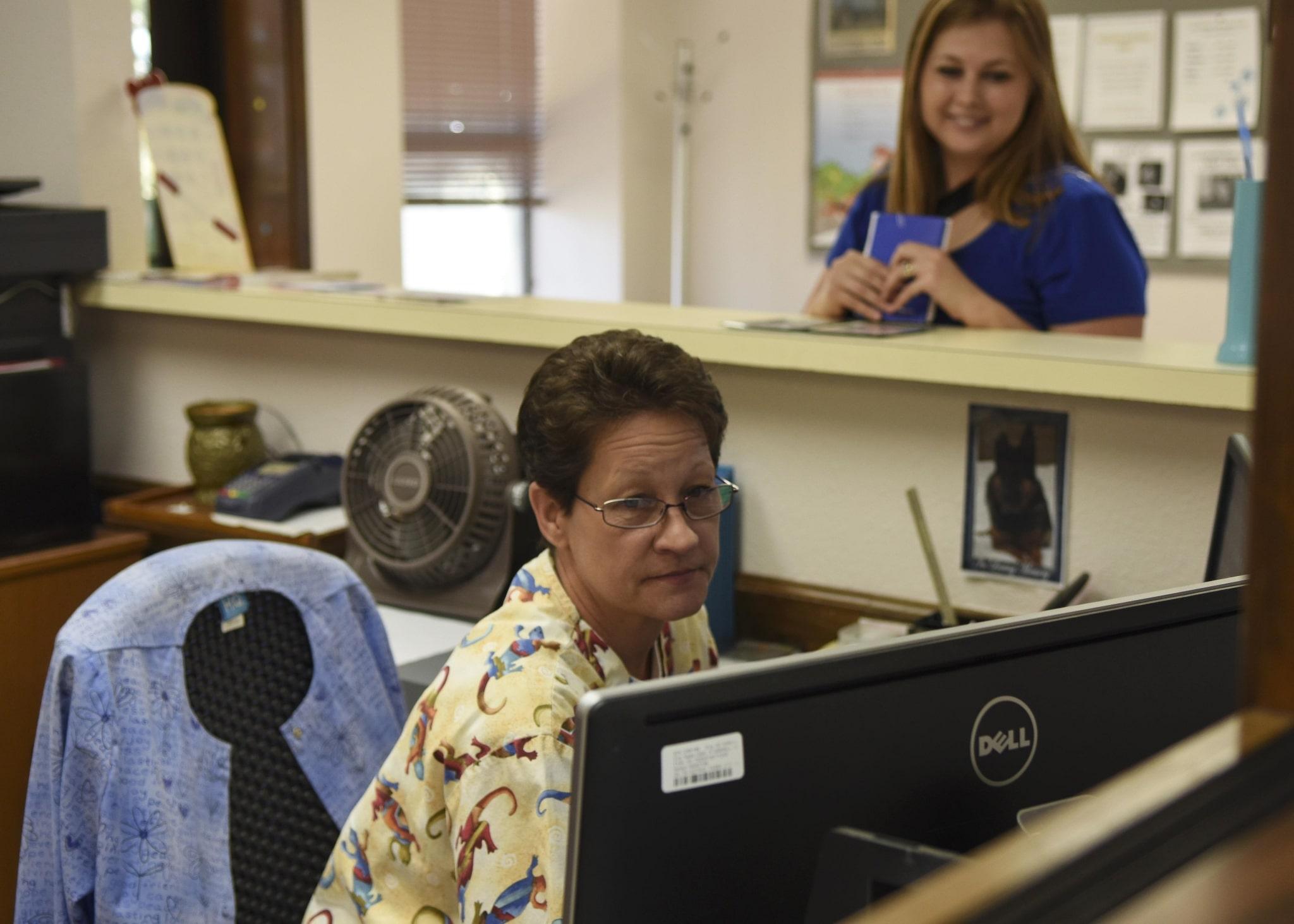 Medical receptionist assisting a patient