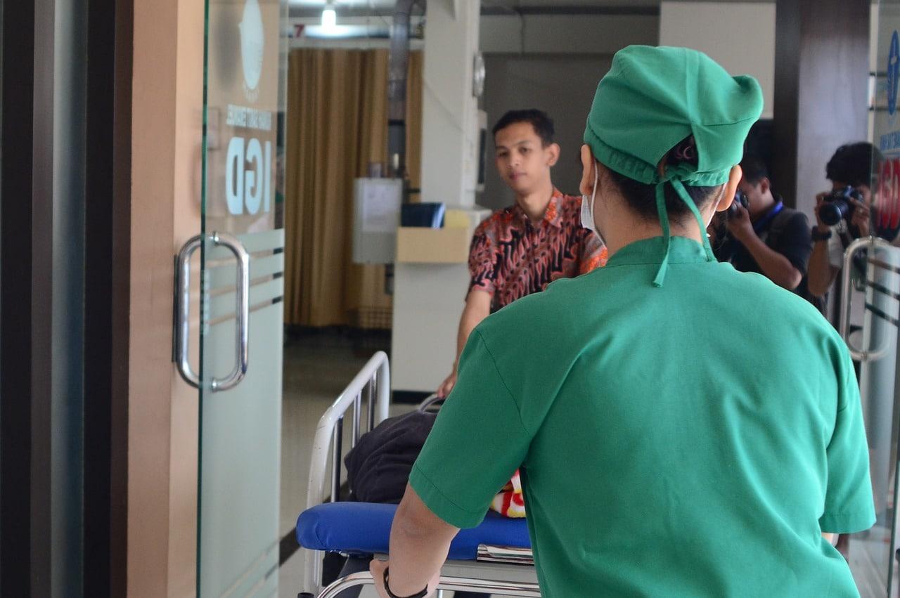 Nurse escorting a patient