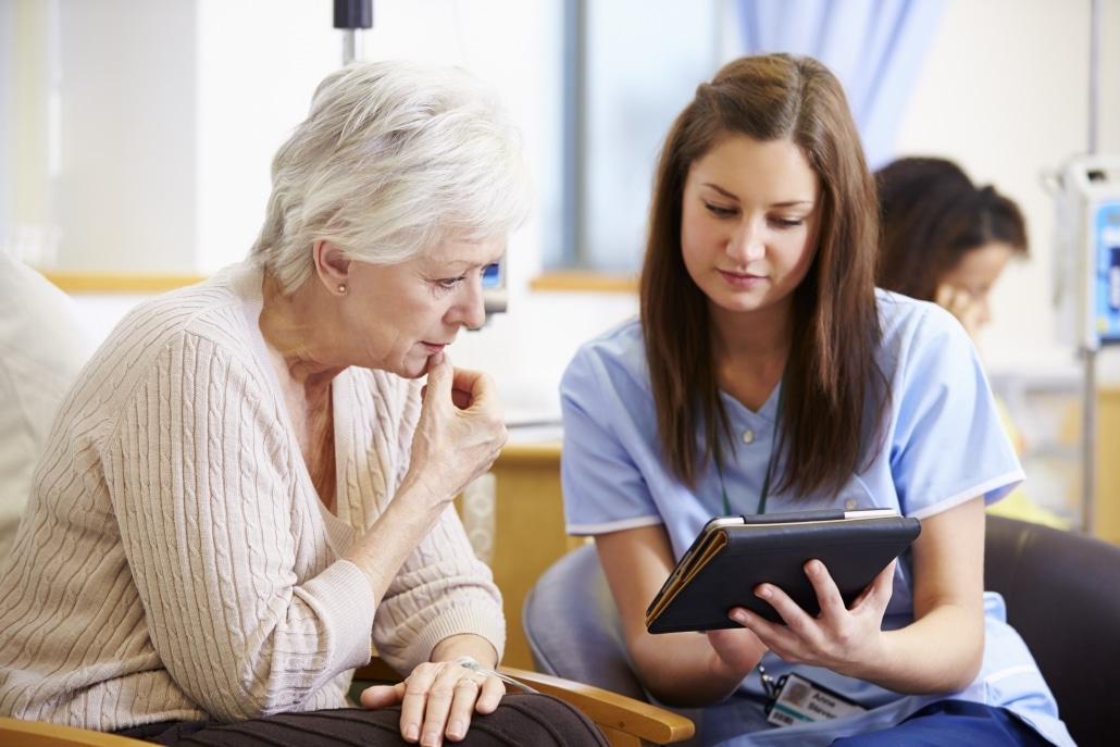 Nurse assisting older female patient